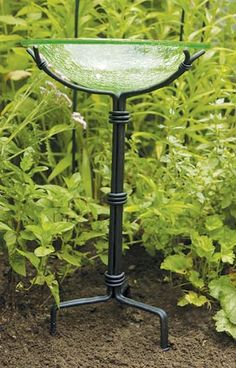 "Achla Tripod Stand with Anchoring Pins, $77, Wrought-iron tripod stand with a black powder coating, comes with three 6"" steel anchoring pins. Use with any non-threaded 12"" diameter bird bath bowls."