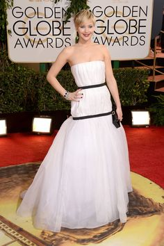 Jennifer Lawrence in Dior with Neil Lane jewelry and a Roger Vivier clutch.