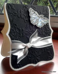 Die cut card in black and white and butterfly.