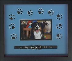 This fun pet photo is creatively custom framed using a paw print design cut into the mat board. The dog's collar is mounted along the bottom edge as the finishing touch
