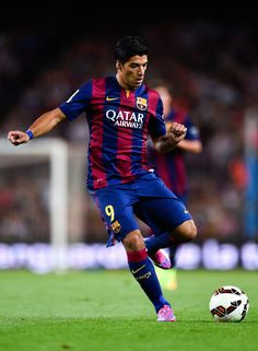 Luis Suarez of FC Barcelona runs with the ball during the Joan Gamper Trophy match between FC Barcelona and Club Leon at Camp Nou on August 18, 2014 in Barcelona, Catalonia.