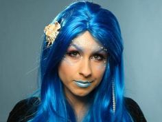 Woman Dressed as Mermaid With Blue Wig, Scales and Faux Pearls