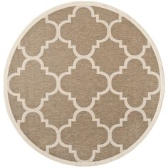 Accent any space, indoors or outdoors, with this brown area rug from Safavieh's Courtyard Collection. Featuring a geometric pattern that give a contemporary feel, this rug is made from polypropylene, making it as durable as it is attractive.