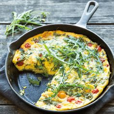 Arugula, cherry tomatoes and a modest amount of goat cheese in an easy frittata that makes a hearty yet healthy brunch entrée.