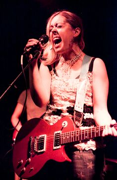 Corin Lisa Tucker is a singer and guitarist, best known for her work with rock band Sleater-Kinney. Tucker was also a founding member of Heavens to Betsy, an influential riot grrrl band, which recorded a split single with Bratmobile, and a number of singles for independent record labels.