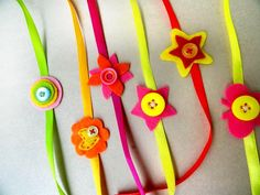 Cute Handmade Rakhis with buttons - We have 15 best ideas to make at home for Rakshabandhan - Perfect rakhi ideas for kids to make, rakhi competition, best of waste, simple and handmade with detailed step by step images- ArtsyCraftsyMom Holiday Crafts For Kids, Crafts For Kids To Make, Kids Crafts, Raksha Bandhan Cards, Handmade Rakhi Designs, Rakhi Making, Monkey Crafts, Paper Quilling Designs, Quilling Ideas