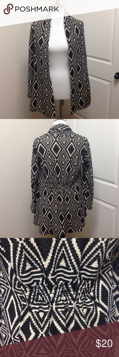 Geo print cardigan sweater Like new cardigan in a bold black and cream pattern / bought as a maternity item but nothing about it limits wearing as a standard size cardigan / warm and comfy / easy way to add visual interest and style to a simple black cami with jeans or slacks / 95% polyester 5% spandex Pinkblush Sweaters Cardigans
