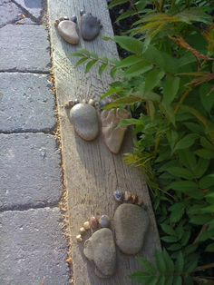 Rock feet! Great for raised garden edge or use hot glue gun to glue to piece of wood and place by a walkway.