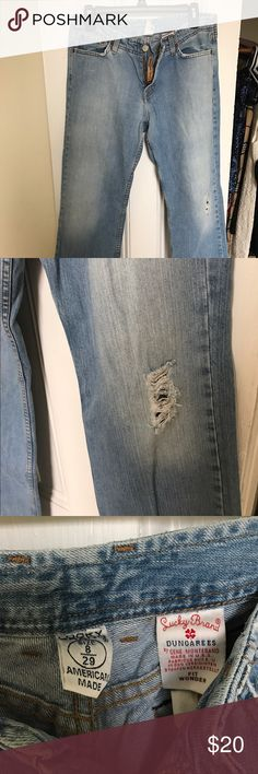 Lucky brand jeans American made lucky brand dungarees size 8/29. They are are a medium blue with the ripped style in one leg. They were only worn once. Lucky Brand Jeans