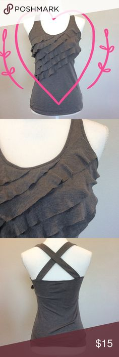 "Eyeshadow Gray Ruffle Tank Top - Sz S - Retail $49 Eyeshadow gray ruffle front tank top with crisscross straps in back. So incredibly comfortable! Gently used condition. Some wear to the fabric with slight pilling. Material: 35% rayon, 65% polyester. Measurements: 26"" length, 16"" bust. Size Small. Retail $49.  ✅Always Authentic✅ ⬇️Bundle & Get 10% Off & Save on Shipping⬇️ ❌Trades❌PayPal❌ Eyeshadow Tops Tank Tops"