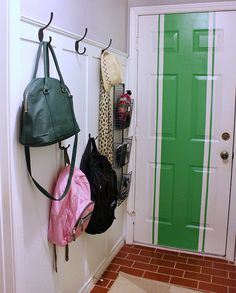 hooks on walls and baskets for stuff  behind front door