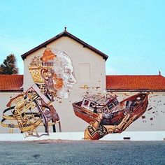 by VHILS & PIXEL PANCHO  (PORTUGAL)