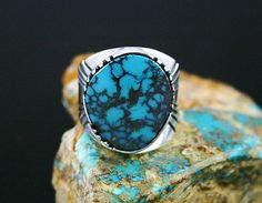 Leonard Nez RARE Gem Grade Pilot Mountain Turquoise Ring | eBay Navajo jeweler Leonard Nez has created this exotic and beautiful ring by selecting an extremely rare gem grade natural Pilot Mountain turquoise. The gem is dark sky blue with deep reddish-brown spiderweb matrix. This look is characteristic of the finest produced at the mine.  $750