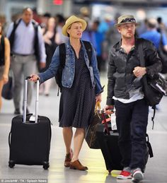 Robin Wright and her fiancé Ben Foster prepared for a train ride out of NYC's Penn Station June 2, 2014