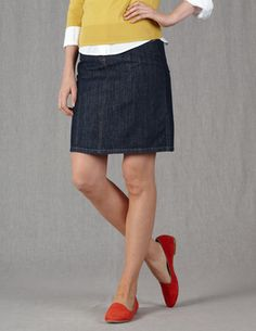 Everyday Mini in indigo denim  www.bodenusa.com. I like the pops of color with the dark denim skirt