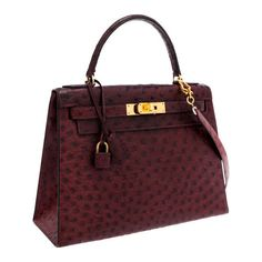 Hermes 28cm Bordeaux Ostrich Sellier Kelly Bag with Gold | Lot #56167... ❤ liked on Polyvore featuring bags, handbags, purses, bolsa, sacs, faux ostrich purse, red handbags, art deco purse, faux ostrich handbags and gold handbags