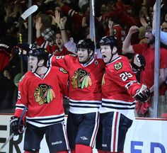 Bryan Bickell (29) with Andrew Shaw and Viktor Stalberg celebrates his goal in overtime. hahaha I love the faces of the Hawks! Great bunch of good-lookin guys ;) #Blackhawks #nhl Game 1
