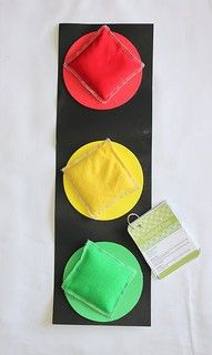 go dog go game...this would be good with a cardboard box with 3 huge holes in it, with large disposable plastic bowls inserted and painted red, yellow and green.