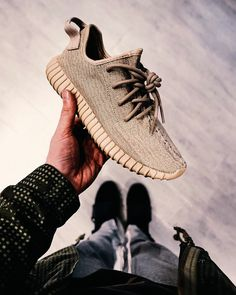 A pair of tan Yeezys.
