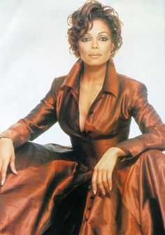 Janet Jackson -- love this style - 50s day dress w/ updated fabric/colors. Lovely