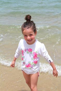 The perfect floral rash guard for your little girl, just in time for summer