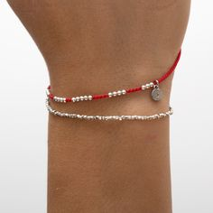 Pure sterling silver beads on red silk cord. The beads are moveable on the silk thread. logo charm contains a tiny diamond. Red Silk, Silk Thread, Silver Beads, Cord, Pure Products, Sterling Silver, Diamond, Bracelets, Collection