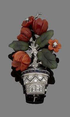 An enamel, gem-set giardinetto brooch, circa 1925 The finely pierced basket, millegrain-set throughout with single and brilliant-cut diamonds, highlighted with a row of calibré-cut sapphire and applied black enamel, to a single-cut diamond stem issuing carved coral corallium rubrum flowers and nephrite leaves, to a reverse engraved with floral motifs, diamonds approx. 0.40ct total, length 4.3cm