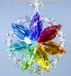 m/w Swarovski Crystal Chakra and Clear Mandala Star of Life Lilli Heart Designs Swarovski Crystal Figurines, Swarovski Crystals, Beaded Ornaments, Christmas Ornaments, Snowman Ornaments, Christmas Tree, Chakra Colors, Hanging Crystals, Rainbow Crafts