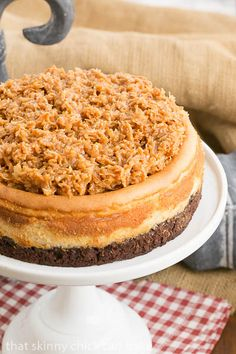 Samoa Cheesecake | A brownie base, vanilla cheesecake and caramel coconut topping!