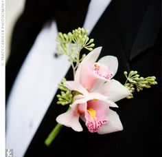 Cute orchid boutonniere for the wedding guests