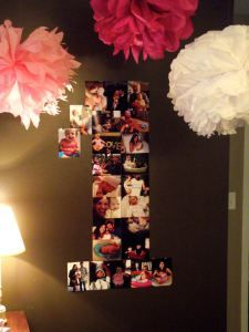"""Pink one year old birthday party -- giant number """"1"""" on the wall made out of pictures from her first year."""