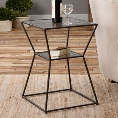 The captivating Uttermost Auryon Iron Accent Table takes a cue from M.C. Escher to enliven your living space with a harmonious geometric hourglass for...