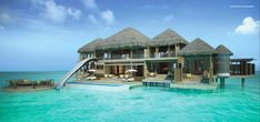 hut homes built over ocean with glass floor | How's this for an over water bungalow?