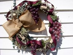 Vineyard themed wreath on natural WV grapevine with a burlap bow, dried flowers, and local wine corks