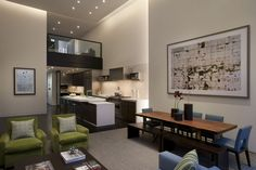 The openness of the floor plan makes for easy gatherings, and moving from one section to the next: after a sumptuous meal, the group can head over to the sitting area for a movie and some conversation or vice versa. The pops of kiwi bring a degree of brightness not found in other areas of the house. -
