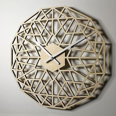 *Natural finish shown. A modern, geometric design wall clock. Made from laser cut birch plywood. Available in natural with a clear polyurethane,
