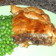 Steak, kidney, mushrooms, beef stock and beer form the base of this all-time classic pie. Be sure to cook the filling gently and thoroughly to allow the different flavours to mix Beef Stew Meat, Beef Steak, Pork, Pie Recipes, Gourmet Recipes, Healthy Recipes, Healthy Food, Yummy Food, Meat Hand Pie Recipe