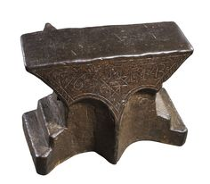 AN IRON ANVIL, DATED 1763, PROBABLY GERMAN of 'Church Window' form, with flat face and square ends, the front decorated with incised hatched border-ornament enclosing a star dividing the date '1763' and the initials 'E. F. B.', formed with two pronounced 'windows' beneath, the rear incorporating a conical horn, stepped base, and an aperture on each side for lifting (bent in profile) 36 cm; 14 ¼ in x 45.5 cm; 17 ¾ in x 28 cm; 11 in