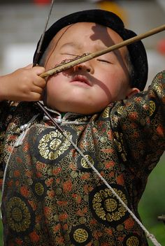 Mongolian child concentrating