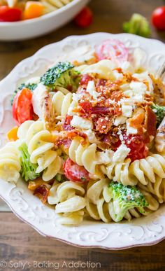 Creamy Bacon Chicken Pasta Salad that will have everyone begging for the recipe! All tossed together in a creamy Greek yogurt dressing. sallysbakingaddiction.com