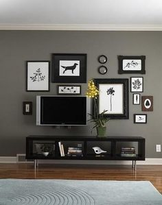 TV and books are part of this wall arrangement.    Offset...black/white artwork