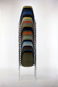 """darksilenceinsuburbia:  """"  Charles and Ray Eames: Stacking Chairs 1957  """""""