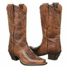 The ornate Ariat Rhinestone Cowgirl boots will make you look like a line dancing queen. Leather upper in a Western boot style with a square, snip toeScalloped leather heel and toe overlaysRhinestone accents throughout13 inch pull-on shaft, 12 inch circumference collar with dual pull-on strapsLeather lining and cushioning insoleDuratread(TM) rubber outsole2 inch heel'