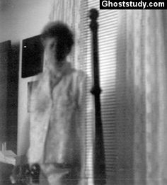 """FULL BODY APPARITION IN HOTEL! From GhostStudy.com - Todd writes: """"This was taken at an old hotel. The ghost lady has been known to appear to the patrons there. She seems to have no left arm while the other arm is transparent."""""""