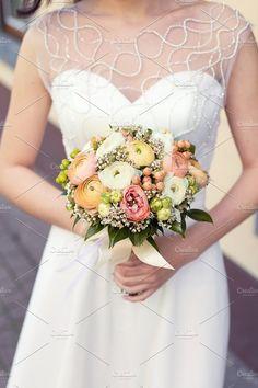 Wedding pastel bouquet ranunculus. Beauty & Fashion Photos
