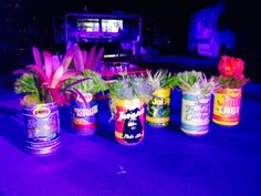 The perfect centerpiece is often a ton of fun to create!  Drink some beer (we chose some great cans from #CigarCity), cut off the tops and put something clever and colorful inside!  Party ready!  www.konceptevents.com