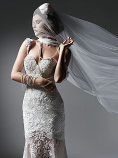 Sottero and Midgley - natasha, DISCONTINUED - Sensual and sophisticated, this fit and flare lace wedding dress features a Milano satin mini-dress, transitioning into an elegant lace and tulle skirt. Finished with romantic sweetheart neckline, beaded spaghetti straps, and covered buttons over zipper closure. Detachable shoulder straps and veil sold separately.