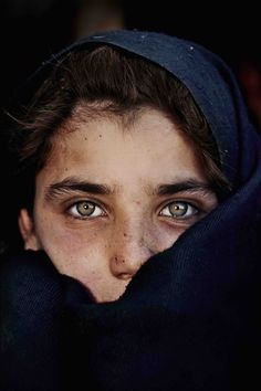 she is featured on the cover of a natural geographic magazine from years ago  love this.  afghan girl with green eyes