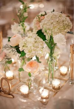 When pretty pink roses and white hydrangeas are brought together and drenched in soft candlelight, the result is the perfect balance of sweet and elegant. This would be a great centerpiece for a shower, rehearsal dinner, intimate birthday celebration, and yes, a small wedding.  www.merrybrides.tumblr.com