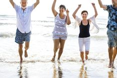 Senior friends playing at the beach | premium image by rawpixel.com Couple Running, Senior Pictures Sports, Beach Friends, Dance Photos, Beach Fun, Beach Photos, Free Images, Cover Up, Photoshoot